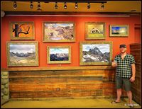 Nature photographer, Chandler Weller stands by his work displayed at Wind River Brew Pub during the Pinedale Artwalk. Photo by Terry Allen.